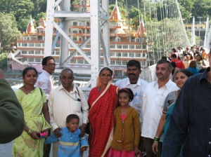 indian family on vacation posing at bridge