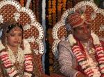bride and groom 'smiling' after flower bedecking