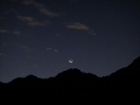NEW MOON SETTING OVER THE MOUNTAIN