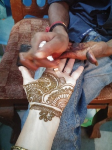 HENNA BEING APPLIED TO MY HAND